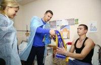 Светличная и Шевченко перед матчем Украина-Сербия встретились с воинами АТО в харьковском госпитале