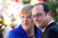Меркель і Олланд сміються