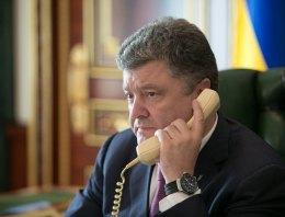Порошенко обсудил с Меркель и Олландом вопрос продления санкций против РФ