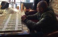 В Киеве бывших милиционеров задержали на $200 тыс. взятки