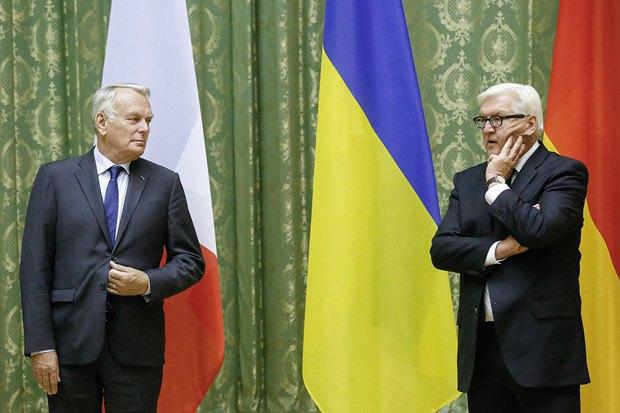 Министр иностранных дел Франции Жан-Марк Эро и министр иностранных дел Германии Франк-Вальтер Штайнмайер во время визита в Киев, 14 сентября, 2016 г