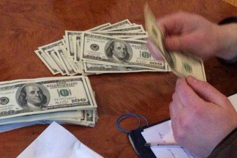 Заступника прокурора Подільського району Києва затримали нахабарі в150 тис. доларів