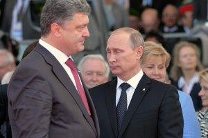 Путин и Порошенко обсудили возможное прекращение огня