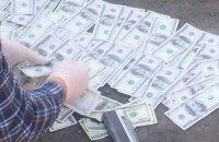 """Сотрудника одесского филиала """"УЗ"""" поймали при получении $10,5 тыс. взятки"""