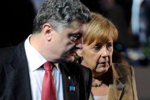 Порошенко и Меркель не увидели прогресса в выполнении мирного плана