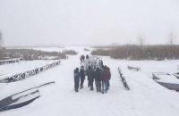 Три человека на снегоходе провалились под лед на Киевском водохранилище