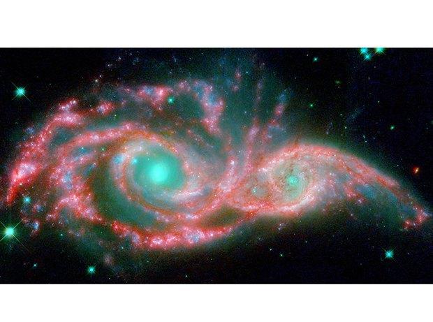 Галактика NGC 2207 сталкивается с IC 2163