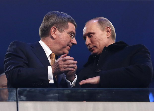 Владимир Путин был одет не так броско, как его спортсмены