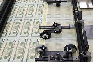 Остановка печатного станка в США ударит по Украине, - Fitch