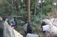 В Ирпене активисты разобрали забор незаконной застройки на участке МВД