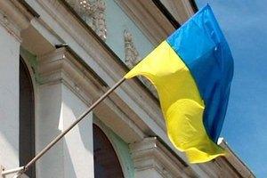 Озброєні люди зірвали прапор України з будівлі Меджлісу в Сімферополі