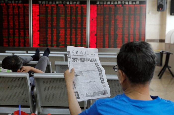 Электронное табло фондовой биржи в Пекине, Китай, 19 июня 2019.
