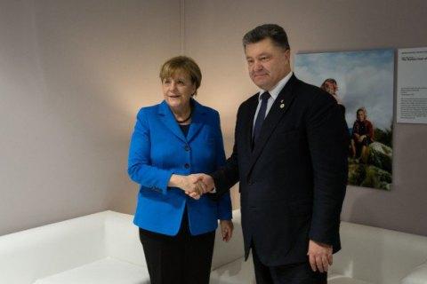 Меркель призвала Порошенко выполнить свою часть Минских договоренностей