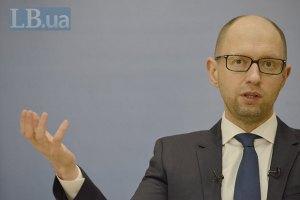 Яценюк: Украина обещает вернуть все взятые кредиты