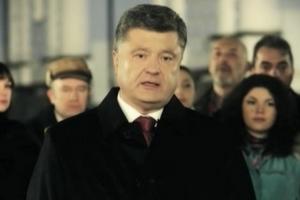 Порошенко провел 2014-й минутой молчания
