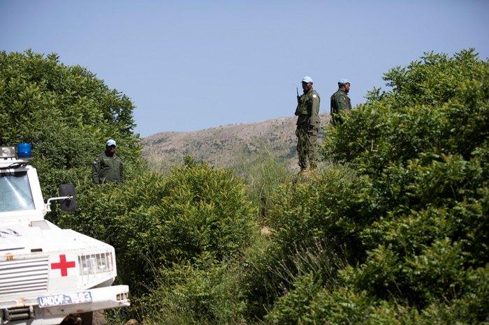 Солдаты ООН патрулируют израильско-сирийскую границу на Голанских высотах, 10 мая 2018.