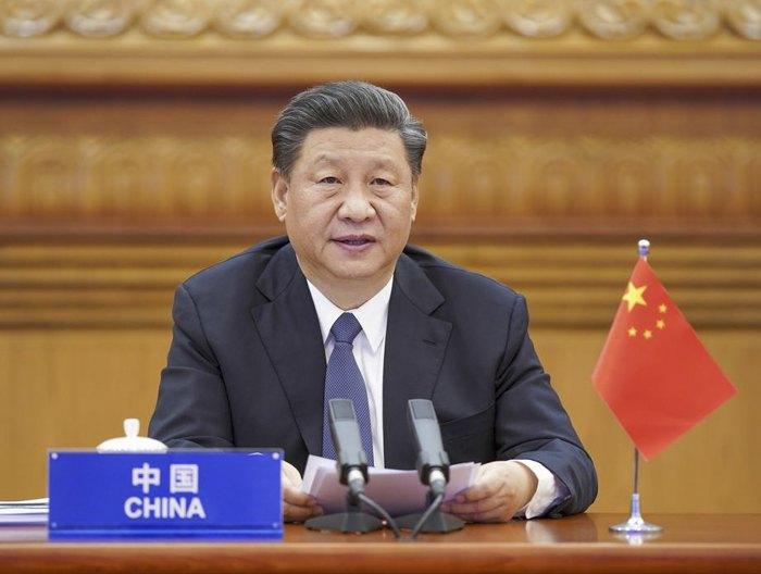 Председатель Китая Си Цзиньпин выступает во время онлайн-саммита лидеров G20 по COVID-19.