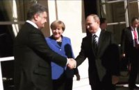 Меркель заставила Путина и Порошенко пожать руки