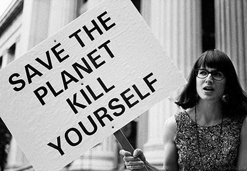 На плакате: спаси планету - убей себя