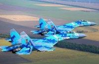 Российский Су-27 пролетел в 6 метрах от американского самолета-разведчика над Черным морем