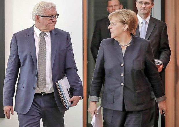 Ангела Меркель беседует с Франком-Вальтером Штайнмайером