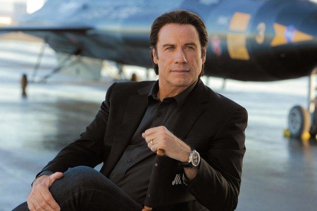 John Travolta watches