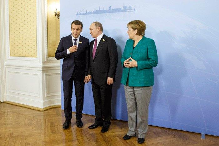 Канцлер Германии Ангела Меркель, президент России Владимир Путин и президент Франции Эммануэль Макрон