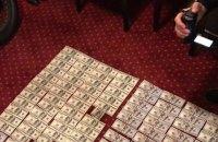 В Харькове задержали двух сотрудников ГФС при получении $20 тыс. взятки