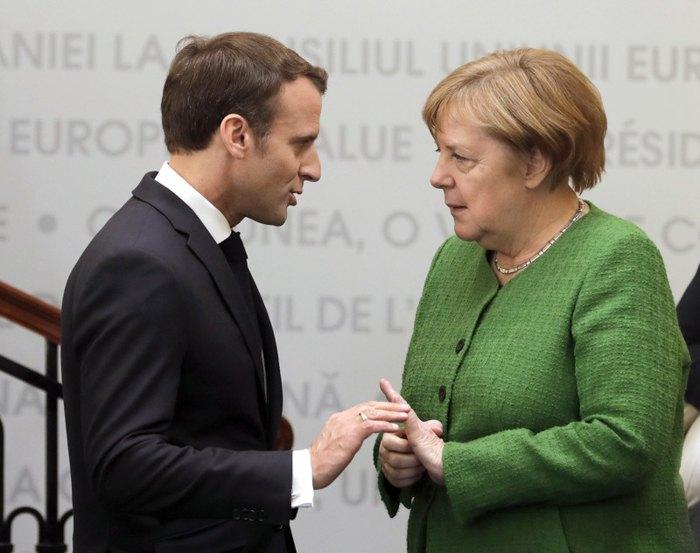 Президент Франции Эммануэль Макрон и канцлер Германии Ангела Меркель во время неформального саммита глав государств и правительств стран ЕС в Сибиу, Румыния, 9 мая 2019.