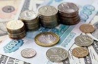 Российский рубль падает из-за цен на нефть