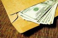 В Днепропетровской области госслужащего поймали на взятке в $400