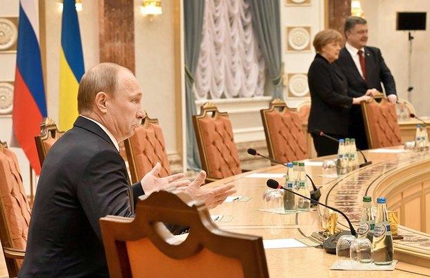 Президент России Владимир Путин, канцлер Германии Ангела Меркель и президент Украины Петр Порошенко во время переговоров в Минске