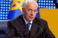 """Азаров выступил в парламенте под крики """"ганьба"""""""