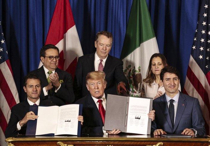 Главы Мексики, США и Канады подписывают USMCA в ноябре 2018.