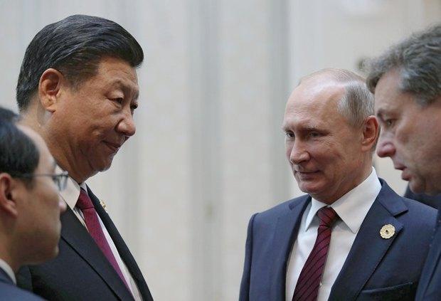 Владимир Путин и Си Цзиньпин в кулуарах саммита АТЭС, Дананг, 11 ноября 2017.