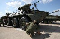 Россия в день выборов стягивает на Донбасс военную технику, - СНБО