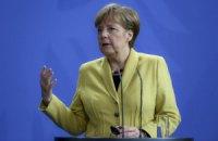 Меркель выступила за проведение местных выборов на Донбассе