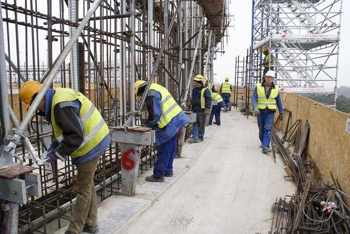 Українці працюють на будові в Польші