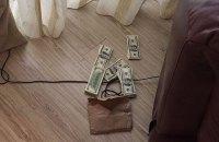 Под Киевом поймали трех человек с 50 тысячами фальшивых долларов