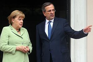 Меркель прибыла в Афины для переговоров