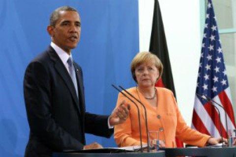 Меркель и Обама призвали стороны выполнять Минские договоренности