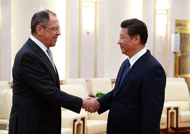 Си Цзиньпин и Сергей Лавров, министр иностранных дел России