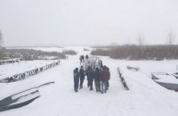 Троє чоловік на снігоході провалилися під лід на Київському водосховищі