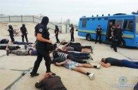 Поліція затримала близько 40 чоловіків біля нелегальної забудови на Осокорках (оновлено)