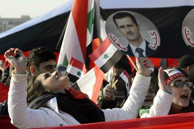 сторонники Башара Асада в Женеве