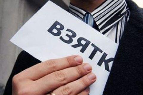 В Запорожской области прокурор задержан при получении 75 тыс. гривен взятки