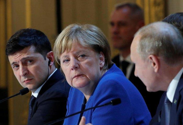 Главы стран *нормандской четверки* во время совместной пресс-конференции по итогам встечи в Париже