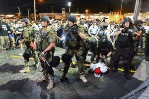 Полиция американского города Фергюсон извинилась за убийство подростка