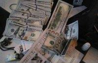 В Киеве адвокат отобрал часть бизнеса и вымогал 3 млн гривен у предпринимателя