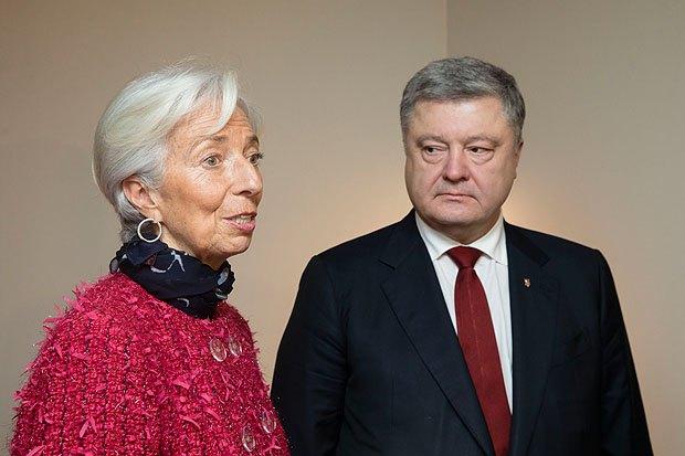 Глава Международного валютного фонда КристинЛагард и президент Украины Петр Порошенко во время встречи на Всемирном экономическом форуме вДавосе